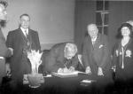 Ramsay MacDonald signs visitors book at Mansion House - 1935
